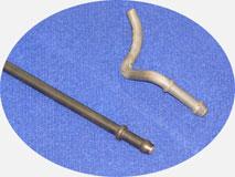Станок для гибки проволочного кронштейна глушителя автомобиля.